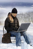 Young girl with laptop. Young girl working from distance royalty free stock image