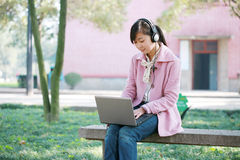 Young girl with laptop Stock Photography