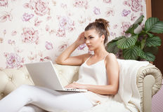 Young girl with laptop. Royalty Free Stock Photo