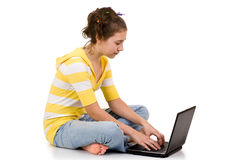 Young girl with laptop computer Royalty Free Stock Photography