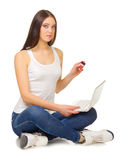 Young girl with laptop and credit card Royalty Free Stock Photography