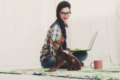 Young girl with laptop and dog Royalty Free Stock Photo