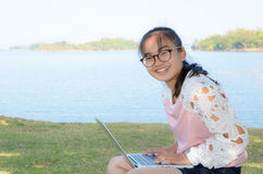 Young girl with laptop on the grass Royalty Free Stock Photo
