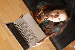 Young girl with a Laptop Royalty Free Stock Photography