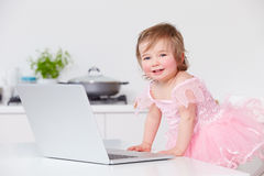 Young Girl With Laptop At Home Royalty Free Stock Photography