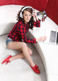 Young girl with laptop listen to music Stock Photo