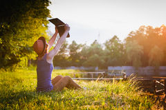 Young girl with laptop outdoors Royalty Free Stock Photo