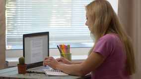 Young girl with laptop stock footage