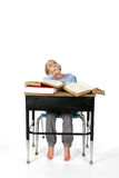 Young girl with large books on her desk Royalty Free Stock Images