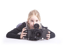 Young girl with large old fashioned camera in studio Royalty Free Stock Image