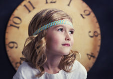 Young girl with large vintage clock Royalty Free Stock Photos