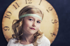 Young girl with large vintage clock Stock Photography
