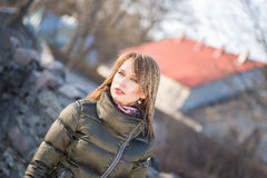 Young  girl in late autumn walking outdoors. Young blond girl in late autumn walking outdoors Stock Photo