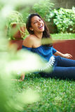 Young girl laugh on grass. In summer park Stock Photos