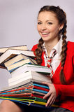 Young girl laughing catches books Stock Images