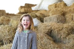 Young girl laughing on farm Royalty Free Stock Image