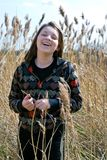Young girl laughing in field Stock Images
