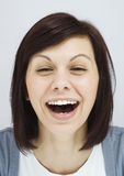Young girl laughing sincerely Royalty Free Stock Images