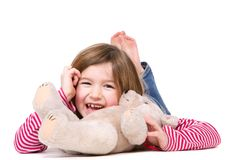 Young girl laughing with teddy bear. Close up portrait of a young girl laughing with teddy bear on isolated white background royalty free stock image
