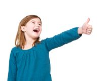 Young girl laughing with thumbs up Stock Images