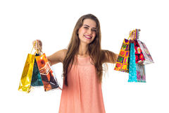 Young girl laughs and holds many different gift packages, isolated on white background Stock Photo