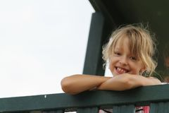 Young girl laughs and looks. The girl laughs and looks royalty free stock images