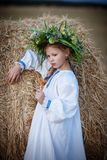 A girl in a shirt in a hayloft Royalty Free Stock Photography