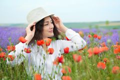 Young girl is in the lavender field, beautiful summer landscape with red poppy flowers Stock Image