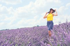 Young girl is in the lavender field, beautiful summer landscape stock photography