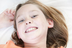 Young girl laying in bed Royalty Free Stock Images