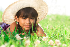 Young girl laying in field Royalty Free Stock Photography