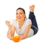 Young girl laying on the floor with fruit salad Royalty Free Stock Photography