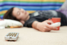 Young Girl Laying On Floor Looking At Television Royalty Free Stock Photo