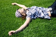 Young girl laying on the grass Stock Image