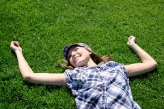 Young girl laying on the grass Royalty Free Stock Image