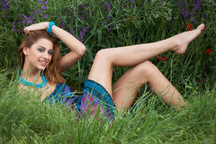 Young girl laying in green grass Stock Photo