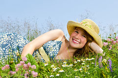 Young girl laying on meadow Royalty Free Stock Images