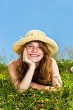 Young girl laying in meadow Stock Photo