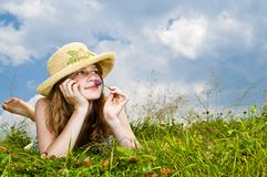 Young girl laying in meadow Royalty Free Stock Photo