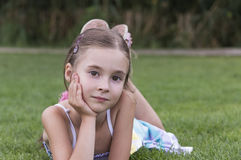 Young girl laying and posing in grass. Portrait of young girl laying and posing in grass Stock Photos