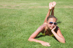 young girl lays on a grass Royalty Free Stock Photos