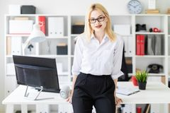 A young girl leaned on the Desk in the office. stock photos