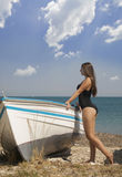 Young girl leaning on a boat. Young teenage girl leaning on a boat, thassos, greece Stock Photo