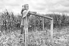 Young girl leaning fence posts Royalty Free Stock Photo