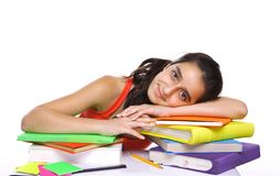 Young girl leaning on her books Royalty Free Stock Photos