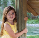 Young Girl Leaning on a Post Stock Images