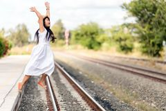 Young girl leaping off a train Royalty Free Stock Images
