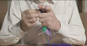 Young girl learn to knit in the classroom or room stock video footage