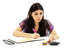 Young girl learning at desk Stock Photo
