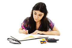 Young girl learning at desk Royalty Free Stock Photos